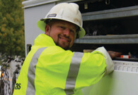 City of Covington Electric Department employee smiling at camera