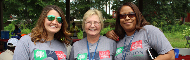 Three Covington Customer Service Representatives smiling at the camera