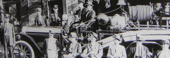 Black and white photo of 1923 mayor and council on firetruck